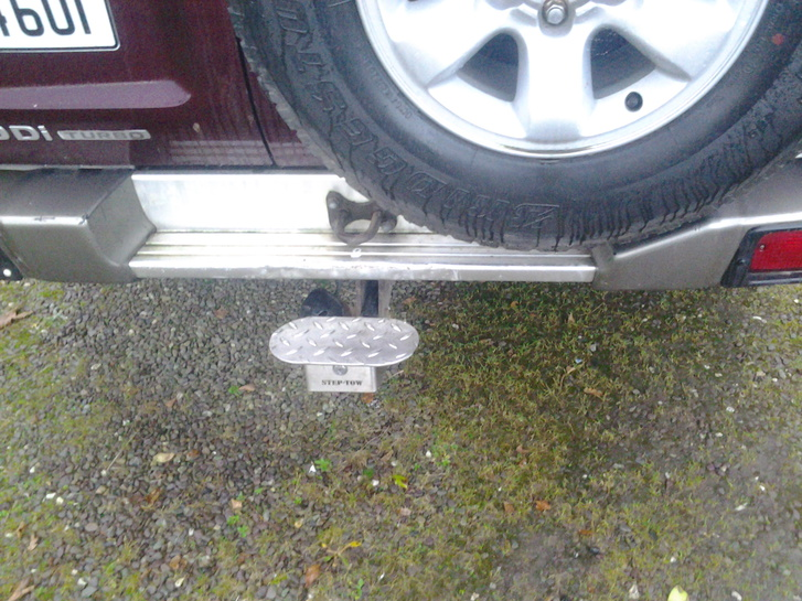a step that fits onto any tow hitch  Vehicles 3